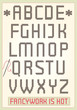 Cross stitch alphabet with sample text
