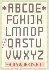Cross stitch alphabet with sample text