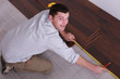 Man laying parquet floors