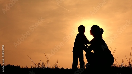 Mother loving son silhouette