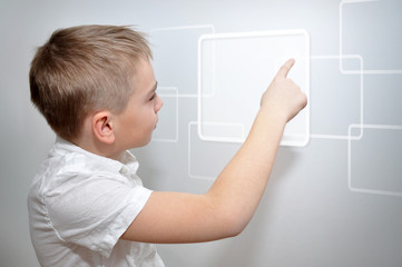 Young boy touching virtual frame