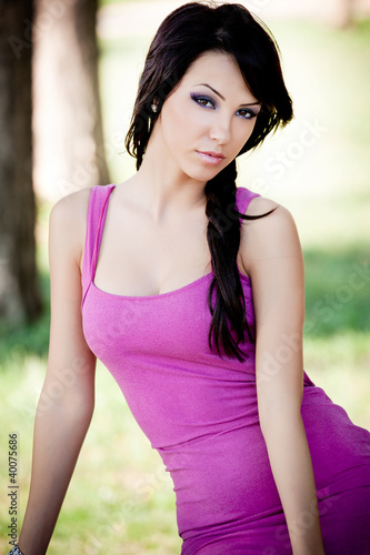 Fashion portrait of young sexy brunette woman