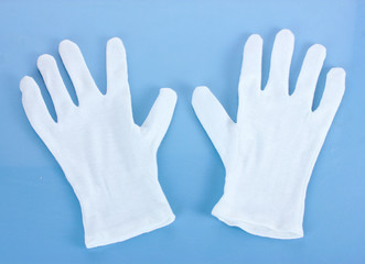 cloth gloves on blue background.