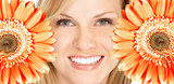 Beautiful woman smile with flower. - 40078605