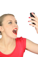 Woman looking at her mobile phone in disbelief
