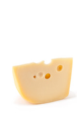 Piece of Maasdam cheese isolated over white