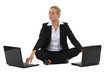 Blond businesswoman sat with two laptops