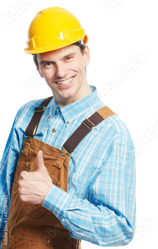 Happy worker in hardhat and overall with thumb up