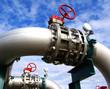 Leinwanddruck Bild - Industrial zone, Steel pipelines and valves against blue sky
