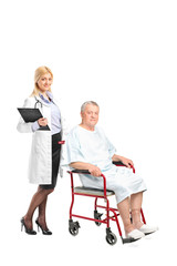 Nurse or doctor posing next to a patient in a wheelchair