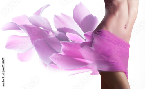 Beautiful woman with petals  on her hips