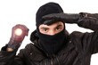 Thief with flashlight isolated in white background