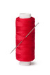 red bobbins of thread and needle