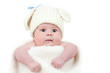 funny newborn baby dressed in Easter bunny cap with eggs