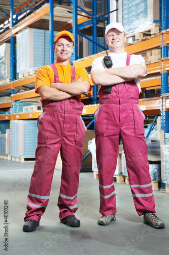 young manual workers in warehouse