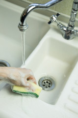 cleaning with sponge scouring pad
