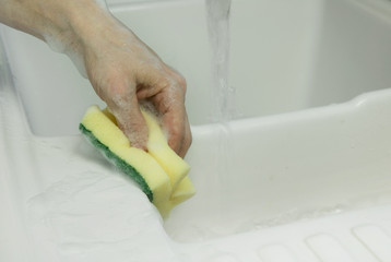 cleaning with sponge scouring pad closeup