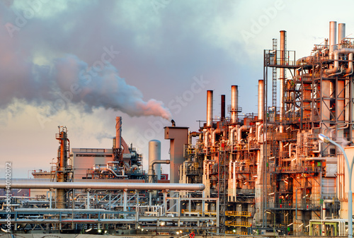 Smoke from the pipes of oil refinery