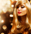 Blond Fashion Girl. Blonde Hair. Golden background