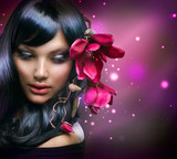 Fototapety Fashion Brunette Girl with Magnolia Flowers