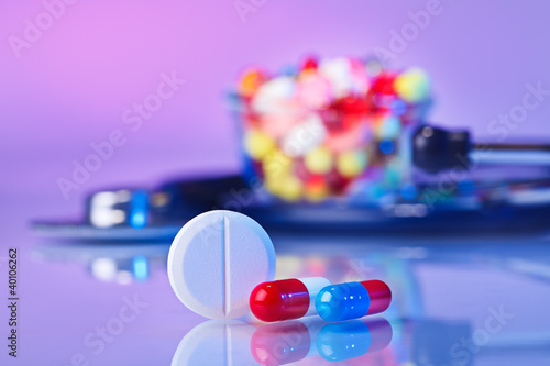 Pills and tablets macro still life on violet, medical therapeuti