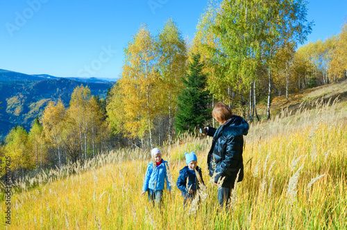 Family walk on autumn  mountain Nimchich pass