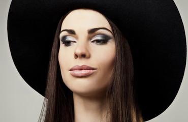 Romantic Beauty in black hat. Retro Style photo.