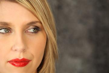 Blond model wearing red lipstick