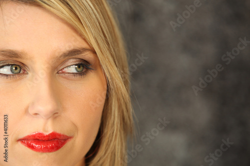 Blond model wearing red lipstick