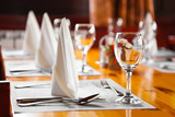 Glasses and plates on table in restaurant - Fine Art prints