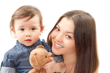 smiling mom and baby girl with toy bear