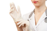 Nurse putting on sterile gloves poster