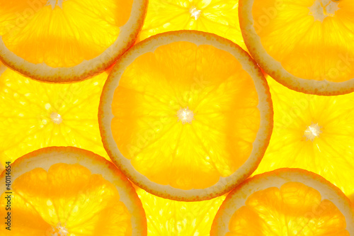 Foto Spatwand Plakjes fruit Orange slices background / macro / back lit