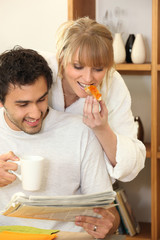 young happy couple having breakfast