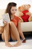 Lovelorn teenage girl at home