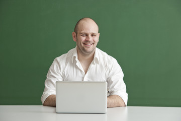 Teacher with smile and Laptop