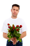 Handsome man is giving bouquet of roses