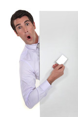 man hiding showing business card playing the fool