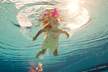 swimming under the water girl with flower