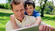 Happy father and son using a tablet computer