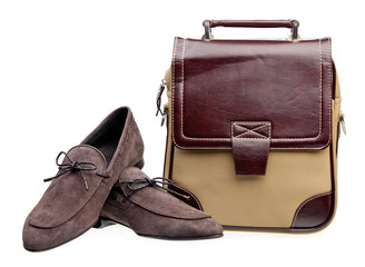 Pair of brown men loafers and messenger bag over white
