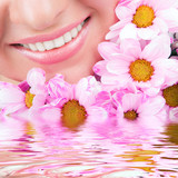 Smile of young woman with flowers - 40125264