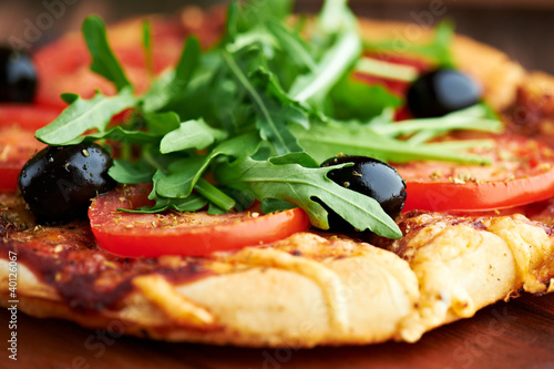 Pizza with tomatoes, olives and arugula © B. and E.  Dudziński