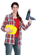 Woman holding an electric screwdriver
