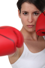 Woman wearing her boxing gloves