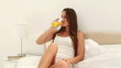 Woman with long hair drinking orange juice