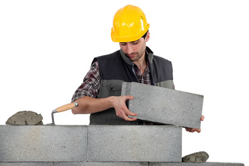 Bricklayer making a block wall