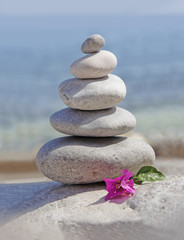 spa stones and flower on sea background