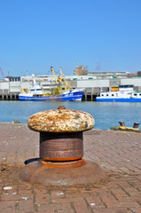 An old bollard on the wharf in a Dutch fishing port.