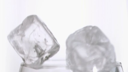 Ice cubes in super slow motion falling together